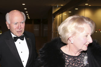 John and Janette Howard arrive at the former prime minister's 80th birthday party at the Australian Club in 2019.