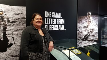 Shelley Roshanbin with her letter on display at the Queensland Museum's NASA exhibition.