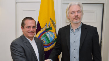 "After meeting Ecuadorean Foreign Minister Ricardo Patino, left, at the embassy in London in 2014, Assange said he'd be ""leaving soon""."