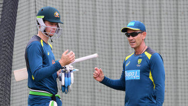 Handscomb talks with coach Justin Langer in the nets.
