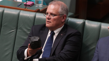 Scott Morrison with the lump of coal he brought into Parliament.