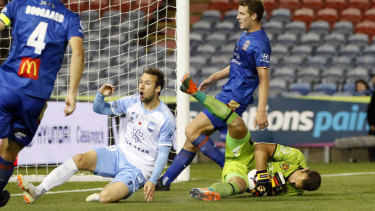 Keeping custody: Glen Moss cleans up the ball for the Jets before Adam Le Fondre arrives.