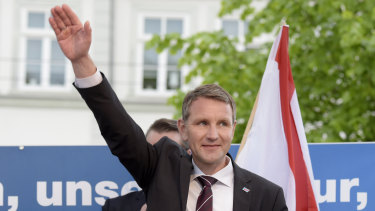Bjorn Hocke waves during a nationalist Alternative for Germany rally in 2016.