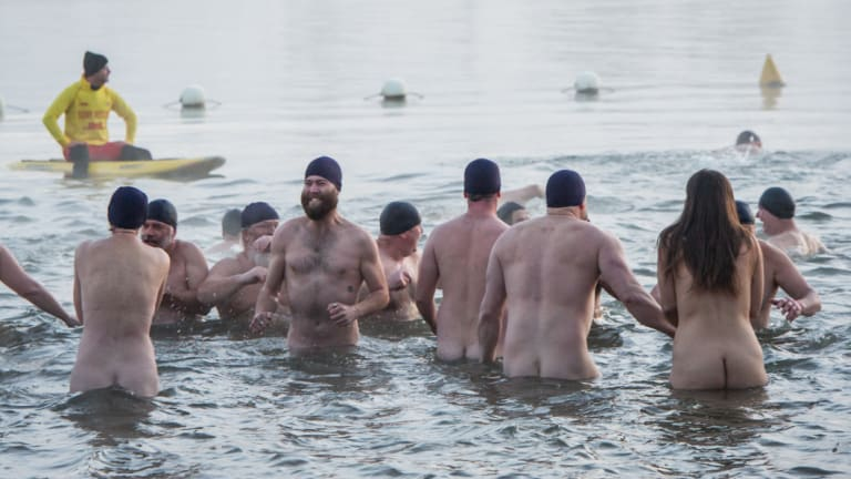 Nude swimmers brave a -3 degree morning for a charity dip in Lake Burley Griffin.