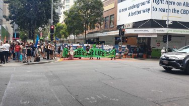 Activists march and chant on Thursday in the latest Extinction Rebellion protest in Brisbane's CBD.