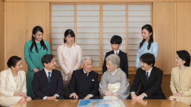 Japanese Emperor Akihito, seated third from left, and Empress Michiko, seated fourth from left, and family for a New Year photo at the Imperial Palace in Tokyo. Prince Hisahito is behind his grand-mother, the Empress.