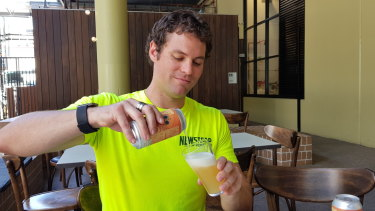 Newstead Brewing Co's Evan Goulden pours a glass of their new seaweed beer- the Moreton Bae.