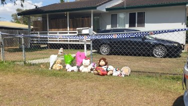 The Logan community in Queensland have left flowers and stuffed animals in honour of the two girls who died.