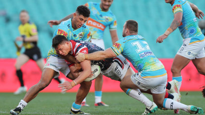 Gritty Titans give depleted Roosters a scare