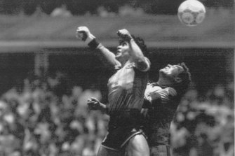 """Diego Maradona beats English goalkeeper Peter Shilton to a high ball and scores the """"Hand of God"""" goal off his left hand in the 1986 World Cup quarter-final."""