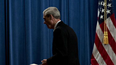 Special counsel Robert Mueller exits after speaking at the Department of Justice.