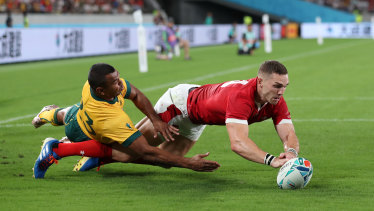 Wales' George North beats Australia's Kurtley Beale to the ball on Sunday night.