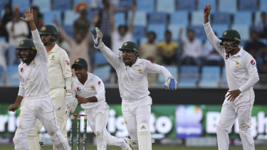 Pakistan players appeal in vain for the dismissal of Australia's batsman Nathan Lyon on Thursday.