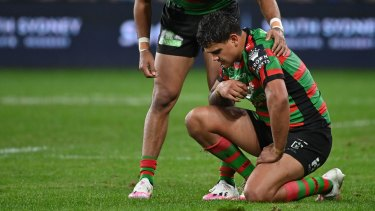Latrell Mitchell is consoled after full-time.
