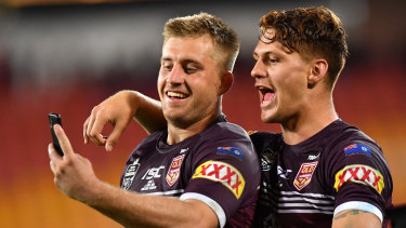 Picture perfect: Cameron Munster and Kalyn Ponga celebrate after the Maroons' victory on Wednesday.