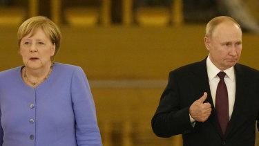 Russian President Vladimir Putin, right, and German Chancellor Angela Merkel.
