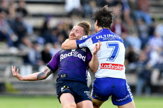 Cameron Munster is hit high in the tackle by Lachlan Lewis in August earlier this year.