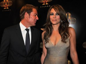 Those were the days: Warne and his ex fiancee Liz Hurley in 2011.