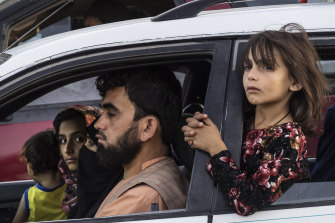 An Afghan family flee their home in the northern province as the Taliban pushed towards Kabul.
