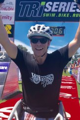 Double amputee Toby Lyndon crosses the finish line to complete his first triathlon.