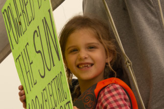 Lila Hart, 6, on the solar-powered boat in New York Harbour.