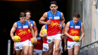 Charlie Cameron leads out the Lions during their impressive win over Port Adelaide on Sunday.