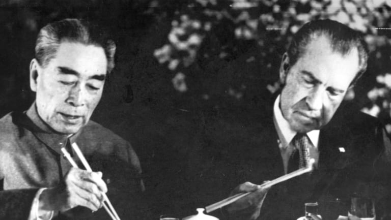 US President Nixon eats with chopsticks at dinner in Shanghai with Premier Chou En-lai AKA Zhou Enlai as he wound up his China visit in 1972.