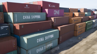 China Shipping Company and other shipping containers are stacked at the Virginia International's terminal in Portsmouth, Virginia, US.