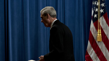 Robert Mueller, special counsel for the U.S. Department of Justice, exits after speaking at the Department of Justice.