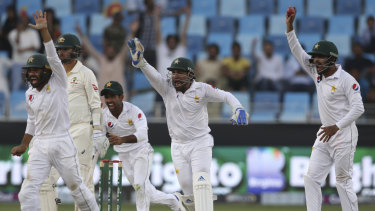 Pakistan players appeal in vain for the dismissal of Australia's batsman Nathan Lyon on Thursday.