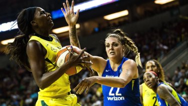 Cayla George (in blue) in action for Dallas Wings in the WNBA.
