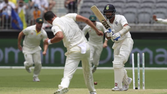 Bunny in headlights: Mitchell Starc bowls Murali Vijay with the last ball before lunch.