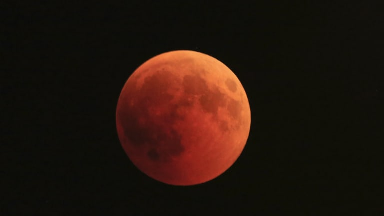 The moon turns red during a total lunar eclipse in Giv'atayim, Israel.