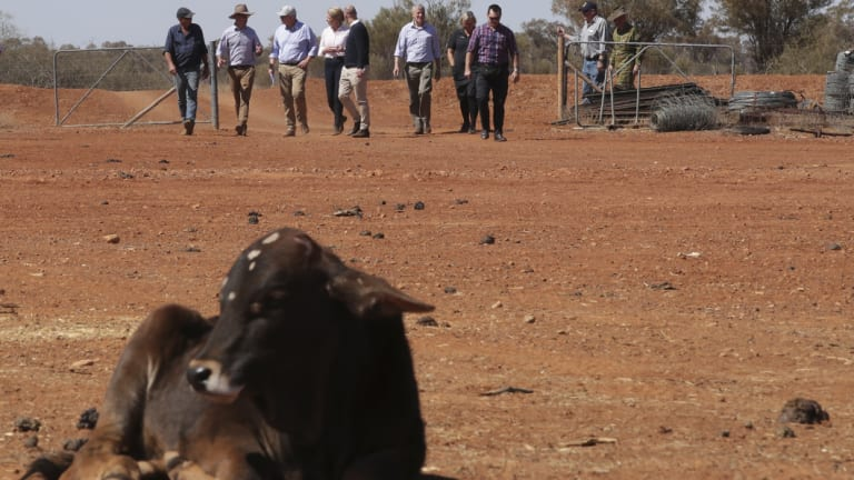 Agriculture Minister David Littleproud (left), with grazier Stephen Tully, Prime Minister Scott Morrison and Deputy Nationals leader Bridget McKenzie at the Tully property in Quilpie during a visit to the Queensland outback on Monday.