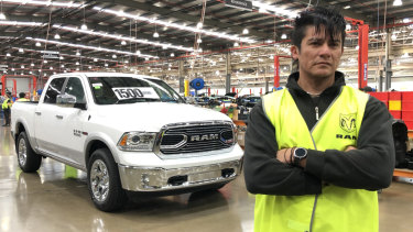 Fernando Carvajal with a Ram pick-up truck at the Clayton car assembly line.