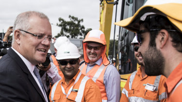 Hammer blows ... Scott Morrison on the campaign trail at the Mulgoa Road Corridor in Penrith on Friday.