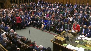 Theresa May addresses Parliament.