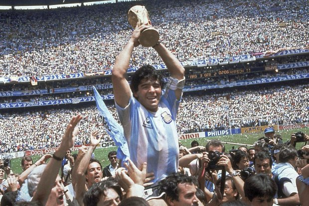 Diego Maradona holds up the World Cup trophy after Argentina's 3-2 victory over West Germany in 1986.