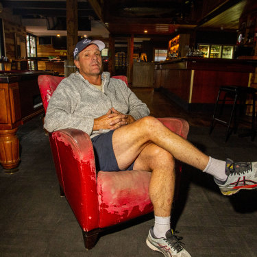 Mallacoota Hotel owner Lou Battel sits in the empty bar.