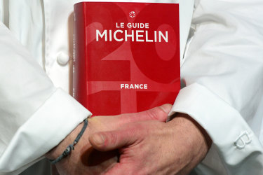 PARIS, FRANCE - FEBRUARY 09:  Illustration picturres with the 2017 Michelin Guide, the little red book that confers the highest gastronomic accolades for his restaurant Le 1947 at Courchevel in Savoie on February 9, 2017 in Paris, France. Chef Yannick Alleno recuperated a third star for his restaurant Le 1947 at the Hotel le Cheval Blanc at Courchevel who had already been distinguished of three stars for his Parisian restaurant Le Pavillon Ledoyen in Paris.  (Photo by Frederic Stevens/Getty Images) Getty image for Traveller. Single use only.