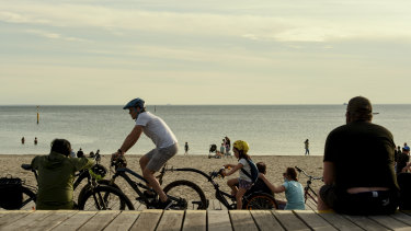 St Kilda Beach was a popular spot for exercise and social catch-ups on Saturday.
