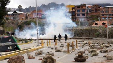 Stones and pieces of wood thrown by pro-Evo Morales demonstrators in the street during clashes with police in La Paz, Bolivia.