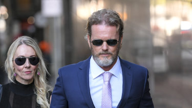 Craig McLachlan arrived at Melbourne Magistrates Court on Friday with his partner Vanessa Scammell.
