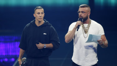 """German rappers Kollegah and Farid Bang, whose song refers to """"my body's more defined than an Auschwitz inmate's""""  receive the Hip-Hop/Urban national award at the 2018 Echo Music ceremony in Berlin."""
