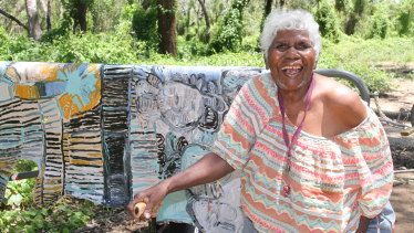 "Sonia Kurarra at Danggu Geikie Gorge with artwork ""Noonkanbah Highway""."