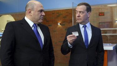 Russian Prime Minister Mikhail Mishustin, left, with his predecessor Dmitry Medvedev.
