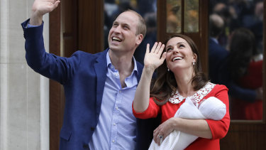 Prince William and Kate, Duchess of Cambridge, hold their newborn son outside St Mary's Hospital/.