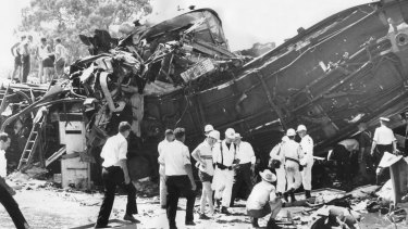 Rescue workers searching the tangled wreckage of the two trains.
