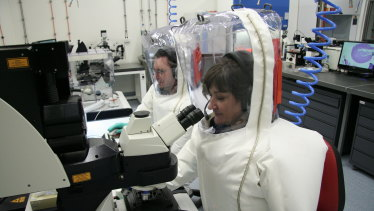 Scientists working in the secure area at CSIRO's Australian Animal Health Laboratory.
