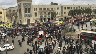 People gathering outside Ramses train station in Cairo after the accident.